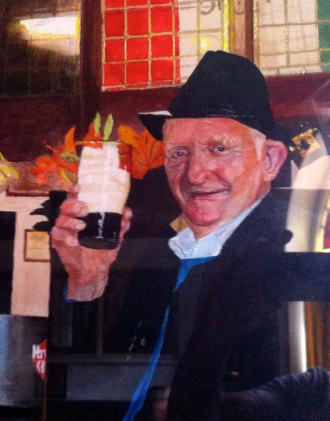 A Painting of a Customer enjoying a Guinness at the bar of The Grapes Trippet Lane Sheffield