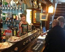 An Image of a smiling bartender at The Grapes Sheffield