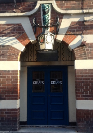 An Image of the Front door at The Entrance To The Grapes on Trippet Lane Sheffield
