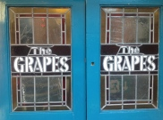 An Image Of The Blue Front Door onto Trippet Lane at The Grapes